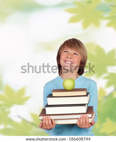 Funny child with many books and leaves of background. - stock photo