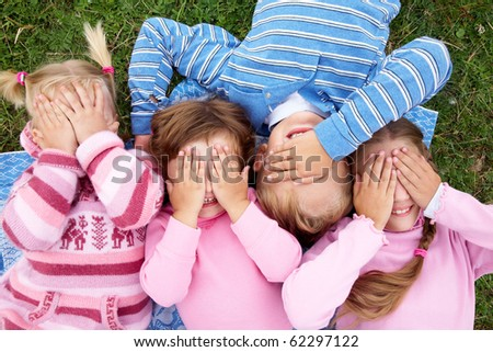 funny children closed their eyes with their hands - stock photo