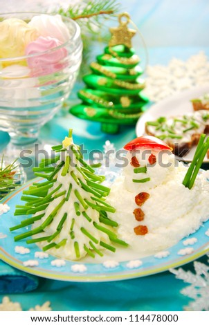 funny christmas breakfast with christmas tree and snowman made from cheese and chive for child - stock photo