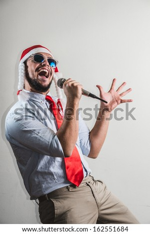 funny christmas business man singing on white background - stock photo