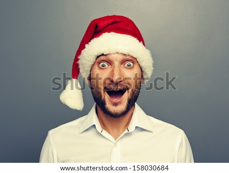 funny christmas man over grey background - stock photo
