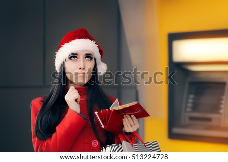 Funny Christmas Woman Holding a Coin  - Sad girl spending all her money on holiday shopping