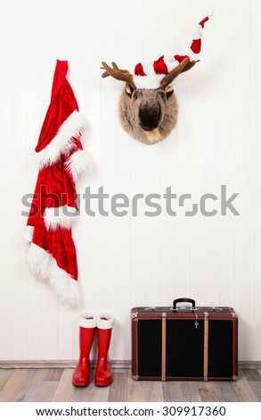 Funny classical santa christmas decoration background in red and white colors. - stock photo