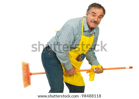 Funny cleaner mature man riding broom isolated on white background - stock photo