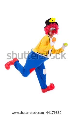 funny clown holding color balls (isolated on white) - stock photo