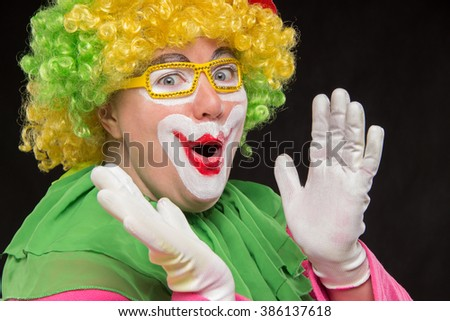 Funny clown in shiny glasses with good cheerful emotions
