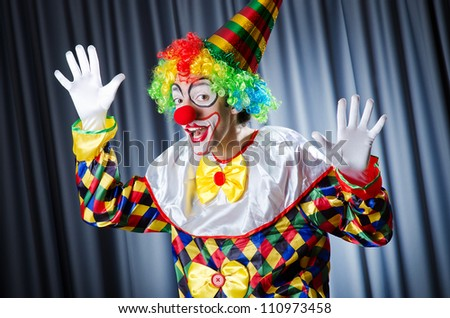 Funny clown in studio shooting - stock photo