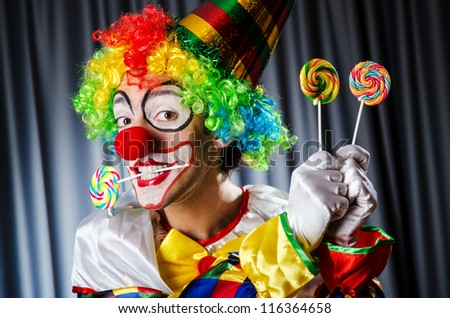 Funny clown in the studio shooting - stock photo