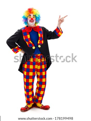Funny clown pointing and calling attention for something on copy space - stock photo