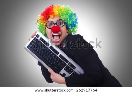Funny clown with keyboard on white - stock photo