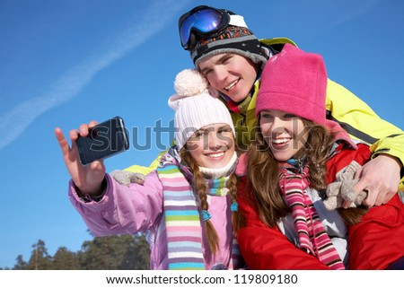 Funny company taking photo in a beautiful winter day - stock photo