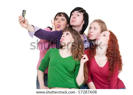 funny company taking picture on the phone. isolated on white background - stock photo