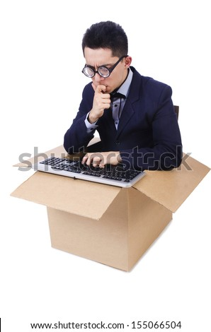Funny computer geek sitting in the box - stock photo