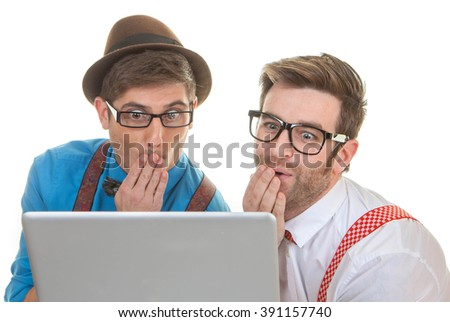 funny computer nerds looking at laptop - stock photo