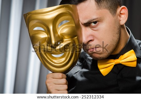 Funny concept with theatrical mask - stock photo