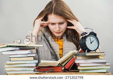 funny crazy  girl student with glasses reading books  - stock photo