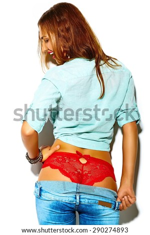 Funny crazy glamor stylish sexy smiling beautiful young sport woman model in summer bright hipster jeans cloth in red lingerie with perfect ass