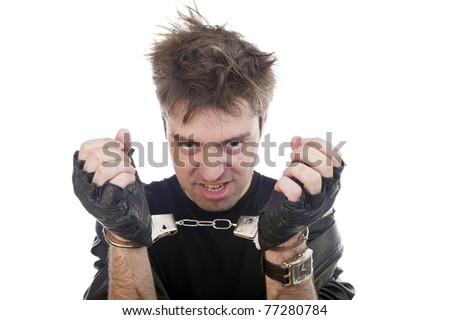 funny crazy young adult maniac guy with handcuffs isolated image, Down's syndrome - stock photo