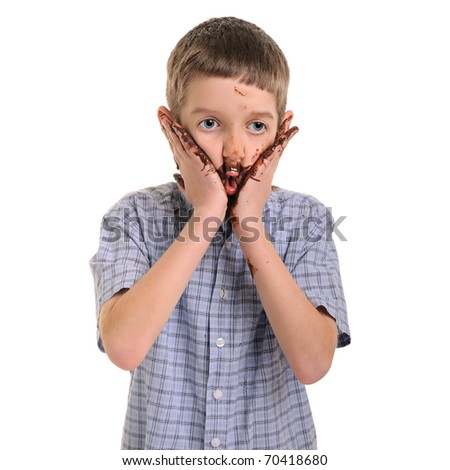 funny, cute dirty and bedaubed boy - chocolate on hands and face - stock photo