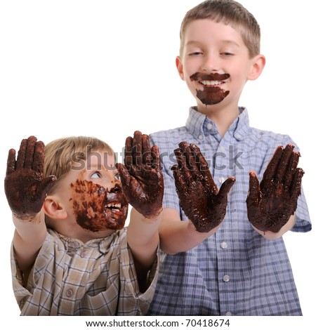 funny, cute dirty and bedaubed boys - chocolate on hands and face