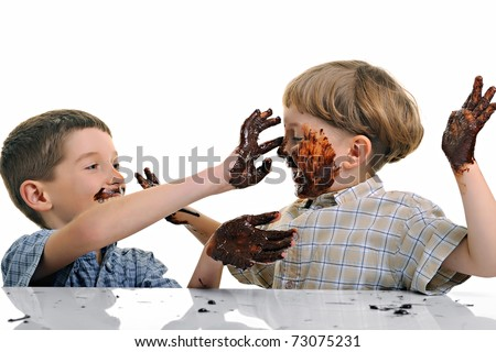 funny, cute dirty and bedaubed boys - chocolate on hands and face - stock photo