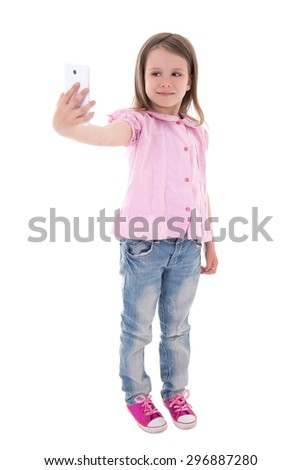 funny cute little girl taking selfie photo with smart phone isolated on white background - stock photo