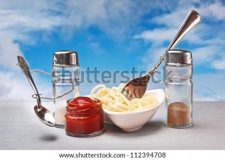 funny cutlery eat Italian pasta - stock photo