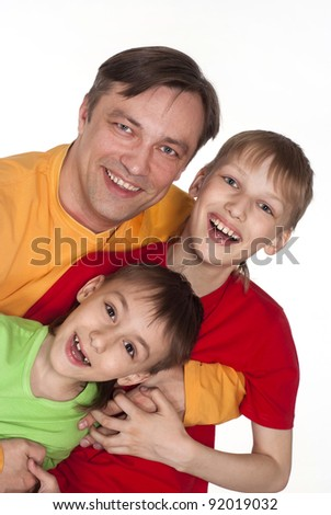 funny dad and two sons in color shirts