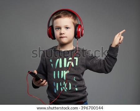 funny dancing child.little boy in headphones.fashionable kid listening music - stock photo