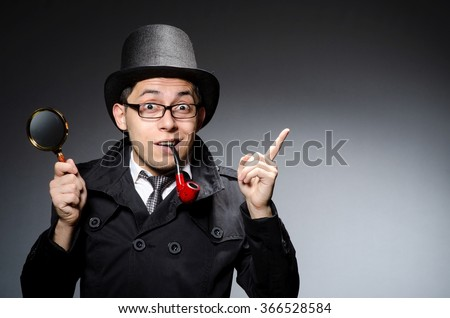 Funny detective with pipe and hat - stock photo