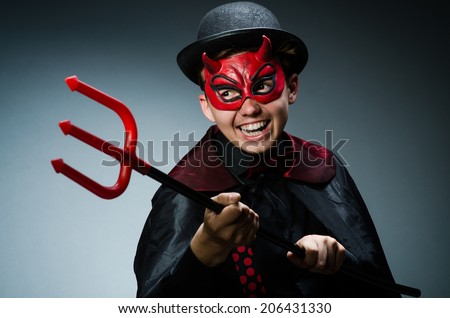 Funny devil against dark background