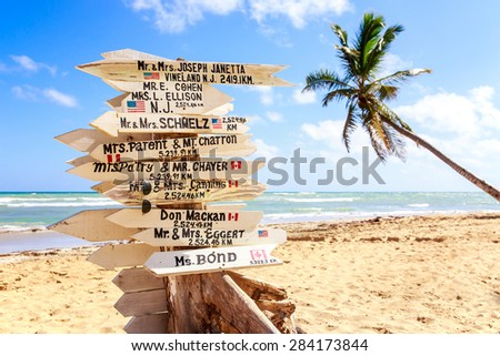 Funny direction signpost with names of newlyweds - stock photo