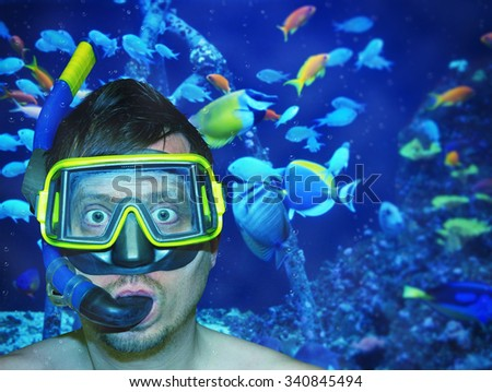 Funny diver in tropical water - stock photo