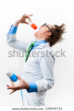 Funny doctor in glasses swallow bolus - stock photo