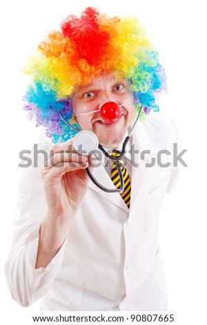 Funny doctor wearing clown nose and colorful wig