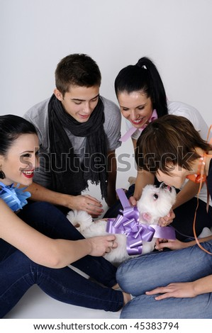 funny dog playing with young people - stock photo