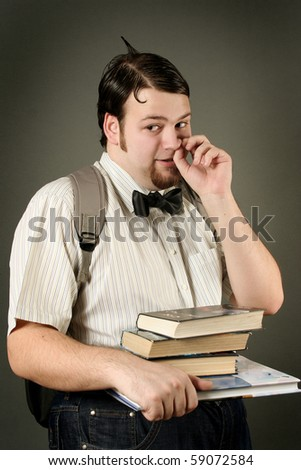 funny eccentric guy on dark background - stock photo