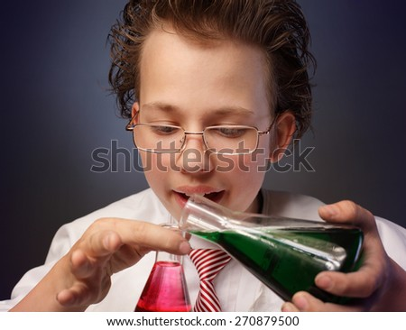 Funny emotional chemist with two flasks - stock photo