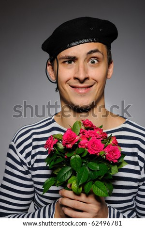 Funny emotional romantic sailor man holding rose flowers prepared for a date