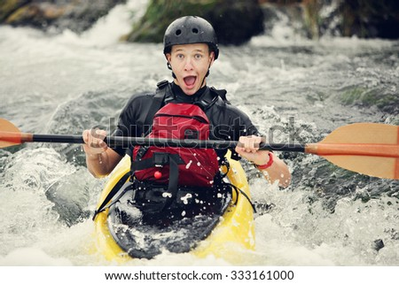 Funny expression on this whitewater kayaker.  - stock photo