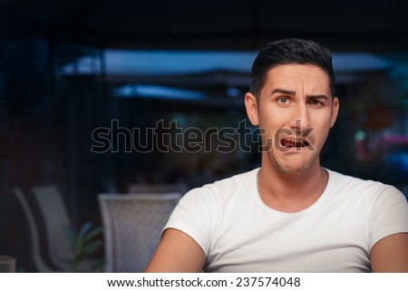 Funny Expressive Man Screaming Desperate - Portrait of a handsome man a making comic face  - stock photo