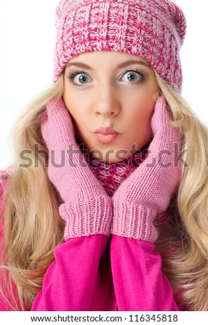 funny face of blonde woman wearing pink knitwear - stock photo