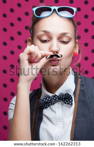 funny face of hipster style girl posing with mustache