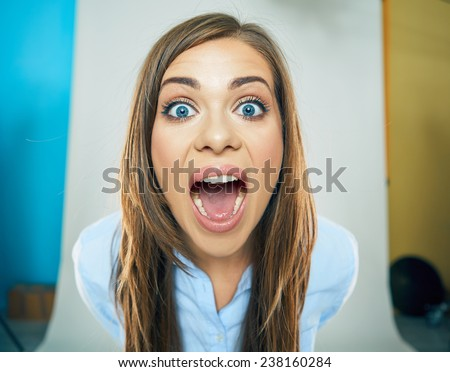 funny face of young business woman . open mouth. teeth. emotional portrait isolated. - stock photo