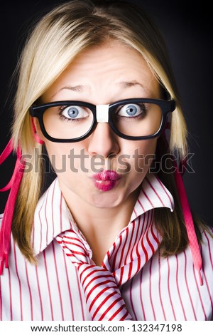 Funny face portrait of an intellectual businesswoman with shocked expression, thinking with pouted lips on dark background
