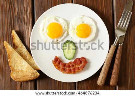 funny face serving breakfast, fried egg and toast