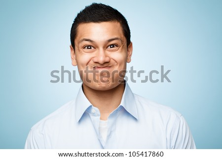 funny face young man close up portrait - stock photo