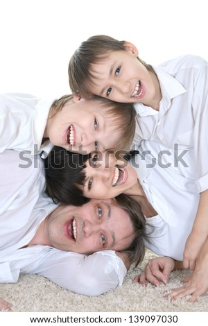 funny family of four spending time together on white background - stock photo