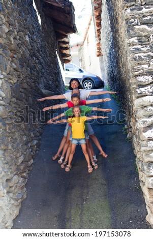 Funny family on narrow street of Canillo, Andorra - stock photo