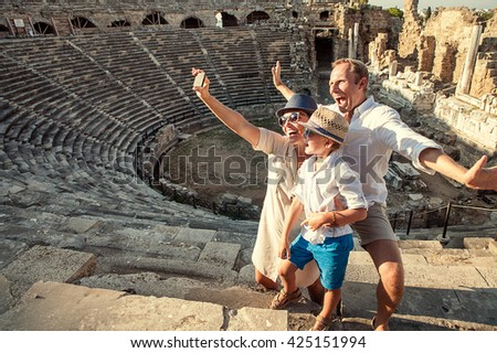 Funny family take a self photo in amphitheater building - stock photo